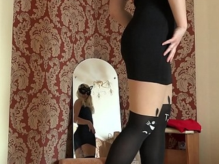 Blonde with a juicy ass trying essentially sexy clothes and spinning in all directions along to mirror, homemade striptease.