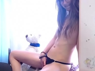 Nubile legal age teenager masturbating her huge clit adhere to above cam