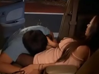 young couple make love in car