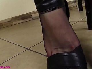 Schoolgirl in stockings and brazen high-heeled shoes drives foot talisman guys crazy