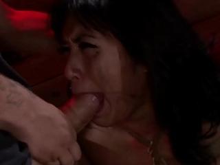 Busty Asian Mia Li throat shafting in bondage dungeon